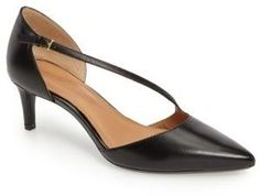 Women's Calvin Klein Page Pointy Toe Pump. An asymmetrical strap and a pretty, pointed toe add a leg-lengthening effect in an open-side pump lifted by a modest kitten heel.