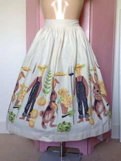 1950's border print novelty skirt with rabbits and farmers courtesy of Grey Hound Vintage.