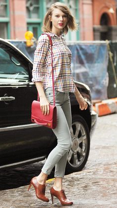 APRIL 15, 2014 Swift ran errands in Soho, expertly matching her red purse to her colorful plaid top. Mint green AG skinnies and Oxford heels completed her look.