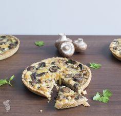 Quiche met kastanjechampignons, walnoten en oude kaas. (Lees het recept via de bron!)