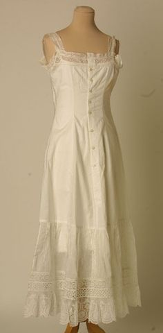 Petticoat: ca. 1910, cotton with lace in frills, pearl buttons, lace infills CF with rows of fagotting, with lace and broderie anglaise flounce at the hem.