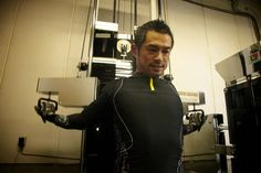 Ichiro Suzuki works out on his personal equipment set up in a storage room of...