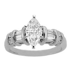 I like this design...it looks unique. With a wedding band it may be super wide though. Marquise Engagement Ring Baguettes & Round Diamonds band  ES367MQWG