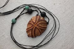 carved avocado seed necklace