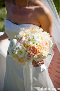 Shape of bouquet and really similar colors.  Add in a little more green and a touch of brighter coral