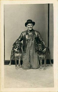 Mike Disfarmer, Untitled [Man in leather jacket kneeling with arms around his two hunting dogs, in front of striped background] Vintage Dog, Vintage Black, Bad Boy Style, Types Of Jackets, History Of Photography, Striped Background, Black And White Portraits, Hunting Dogs, Vintage Pictures