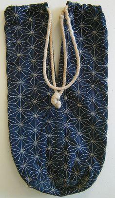 Sashiko stitched, indigo dyed bag, most likely used to carry a sake bottle. Meiji Era (1868-1912).