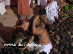 Coconut breaking ritual at Vettakkorumakan Temple Kannur