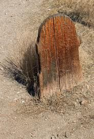 Wooden grave marker, Virginia City, NV.  Grave circa 1850.