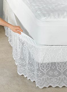 This delicate scalloped lace bedskirt has a fully elasticized top that attaches and removes easily without lifting your mattress. Matching lined pillow shams complete the look. Machine wash and dry.