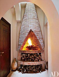 A conical terra-cotta-tile stove | archdigest.com