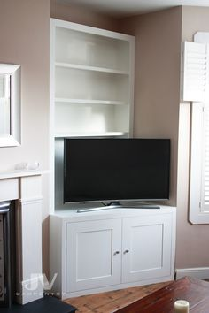 Alcove fitted bookshelves Alcove bookcase with TV cabinet. This piece of fitted furniture has a light in the shelves as well Alcove Tv Unit, Alcove Bookshelves, Alcove Storage, Alcove Shelving, Tv Stand In Alcove, Tv Corner Unit, Corner Shelving Unit, Corner Tv Stands, Open Shelving