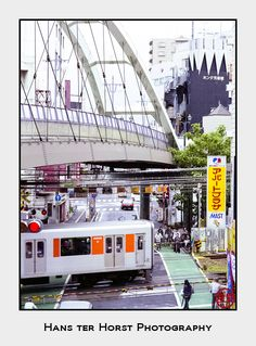 Pedestrian bridge and train crossing in Kawagoe, Japan - Hans ter Horst Film Photography