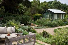 Lovely seating for a Mediterranean style garden in Santa Barbara County. Love the guest house too!   Design Consultation - Jonathan Raith, Inc. - Nantucket Custom Homes