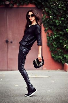 Love!! Head to toe all black! Leather pants, wedge sneakers, clutch!