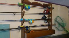 Someone gave us a gun rack...but by law you can't store guns like this anymore.  We were able to store 7 fishing rods like this!  No more tangled line for this family!!!