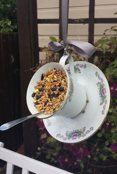 Teacup bird feeder, garden ornament, ideal bird lovers gift. Pretty matching vintage china teacup and saucer, with a spoon perch. Hangs on a pretty silver/grey ribbon. Filled with bird seed and lard mixture which birds love. Some of my bird feeder designs featured in the award winning show garden by John Cavil. For more design see link below. https://www.etsy.com/uk/shop/Prettyvintagehouse?section_id=16325114&ref=shopsection_leftnav_1