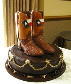 Grooms cake with chocolate boots by Frosted Art