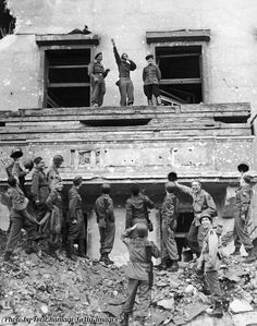 American and Russian armies mimic and mock Adolf Hitler Hitler's famous balcony at the Chancellery in Berlin. Taken in 1945.