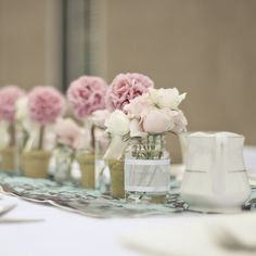 little vases of just a few flowers for my table center pieces like these but with candles too. :)