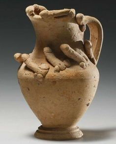 Just what you want on your water pitcher... (Roman terracotta pitcher with interesting adornment).