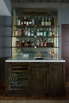 Hanging stack bar with glass shelves and mirror wall, liquor bar ...