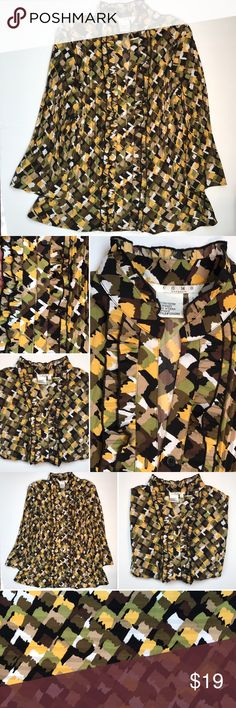 COMO Stretch blouse Stunning blouse very strong colors. It's a stretch and a large black yellow browns tans just beautiful. Please see tags for size, washing instructions and materials. COMO Tops Blouses