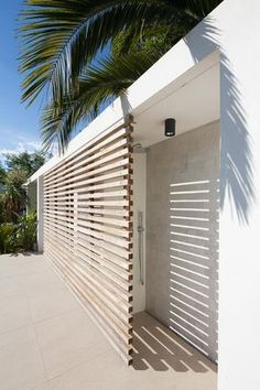 Great to create privacy for exterior entrances like the guest rooms pictured. It also allows that outdoor space to be usable with some lounge chairs or a small table and chairs. Design Exterior, Interior And Exterior, Outdoor Spaces, Outdoor Living, Outdoor Decor, Outdoor Bars, Outdoor Seating, Indoor Outdoor, Outdoor Bathrooms