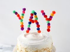 cake decorating ideas: write your message in pom pom balls via Momtastic