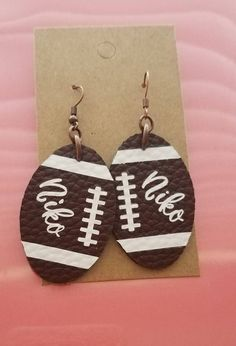 Your place to buy and sell all things handmade - Football earrings, personalized name football earrings, faux leather earrings, football mom, school - Diy Leather Earrings, Bow Earrings, Wedding Earrings, Leather Jewelry, Diy Jewelry Unique, Mom Jewelry, Jewelry Crafts, Jewelry Art, Jewlery