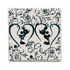 Mickey Mouse Icon Indigo Tile - Mickey and Minnie Silhouette | Disney Store You will always be reminded of Mickey and Minnie's devotion to each other with this decorative tile. Adorned with an indigo floral pattern hugging the silhouettes of our Disney couple, this tile is the perfect addition to your loving home.
