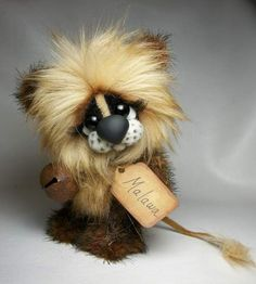 Malawa By Michelle Nunnery - He has premium quality glass eyes.His eyes have eyelashes. His arms and legsjointed with string. His head is jointed with cotter pin and disk.His nose is made from clay.Stuffed with polyfil and bb's for heavy weight.He has been hand sew...