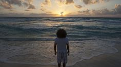 A man watches the sunrise on New Year's Day at Gaviota Azul beach in Cancun January 1, 2014.