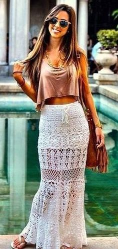 Boho chic street style, crochet maxi skirt with modern hippie crop top gypsy style jewelry.