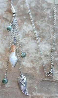 """Angel necklace made with Seraphinite (high spiritual energy that ascends throughout the body, linking the physical/ethereal, opening communication with angelic realm); Tanzanite (joins communication & psychic power, invites protection & safety when exploring higher realms, & allows you to """"listen"""" to higher guidance); Celestite (gentle, calming & spiritually uplifting, works on the higher Chakras, aids angelic communication, opens you to Divine Wisdom & helps you develop psychic gifts)."""