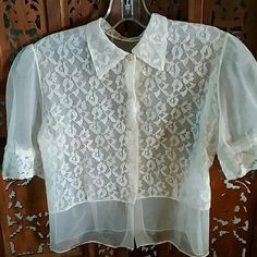 """Sheer Vintage 1950s White Lace Blouse 1950s sheer blouse with lace panels and lace trimmed sleeves. Pointy collar. Only two of the five rhinestone  buttons are still in good shape. No tags. Feels like nylon. Measures about 16.5"""" flat across chest armpit to armpit. In fair to good vintage condition. Could use a good soaking. Vintage Tops Blouses"""