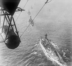 HMS QUEEN ELIZABETH and other British battleships in line astern, photographed from a naval airship.