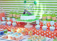 Here's two simple ideas I like - plastic dinosaurs for decorating the cake or the table; individual drink bottles or drink poppers, decorated with a printed label (look on etsy.com for themed party printables).
