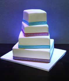 4 tier rotated square cake with pop of colors