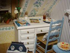 miniature desk and dollhouse