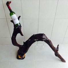 Driftwood bottle and glass stand from www.artisansofabidjan.com