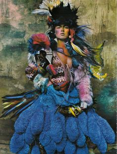 ethnic, blue fur tail skirt, multi color bolero with black headdress and colorful feathers