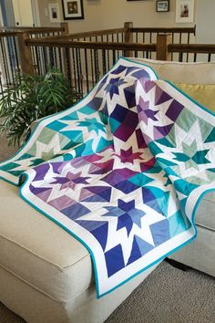 Simple pieced stars shine in this modern quilt.