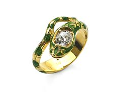 A gold, enamel and diamond ring int he form of a coiled snake, symbol of eternity. (FoFo)