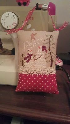 """Pillow ornament finish by Natasha/ Crafty5  Sam Sarah """"Peace"""" from Just Cross Stitch Magazine Christmas Ornament Issue 2009."""