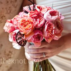 the color cues of pink, yellow, and coral are beautiful in a bouquet of garden roses