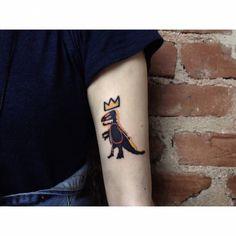 Basquiat inspired T-Rex tattoo on the arm. Tattoo artist: Alican Görgü