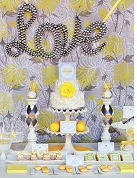 Use simple fabrics to enhance the theme of your celebration. Here, a floral backdrop with a fancy letter marquee pops against an elegant, springy dessert table setting. Engagement Party Desserts, Engagement Parties, Yellow Desserts, San Valentin Ideas, Fancy Letters, Yellow Theme, Desert Table, Elegant Bridal Shower, Mellow Yellow