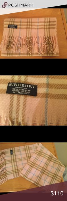 Authentic Burberry Pink Cashmere scarf . Authentic Burberry pink cashmere scarf in very good pre owned condition . No rips no spots . Price firm . Burberry Accessories Scarves & Wraps