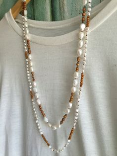 Long Freshwater Pearl and Wood Necklace Hand by GirlwiththePearl1